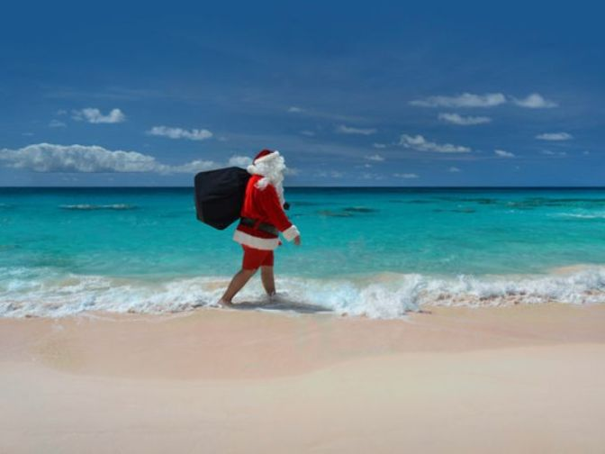 635853563813200149-bermuda-santa-in-shorts-on-the-beach-credit-hamilton-princess-bermuda